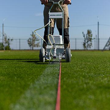подготовка футбольного поля к играм